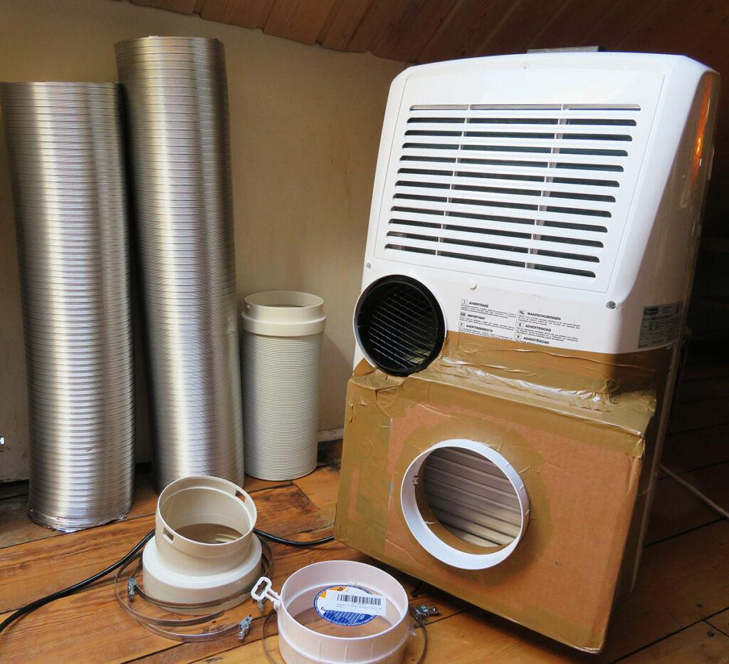 Modification portable air conditioner - Attach hoses to portable air conditioner 01