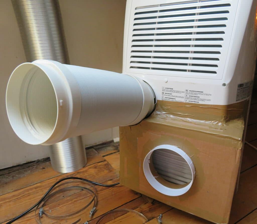 Modification portable air conditioner - Attach hoses to portable air conditioner 02
